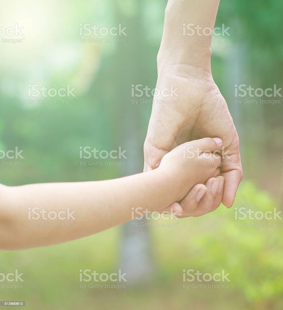 Father hold child hand stock photo