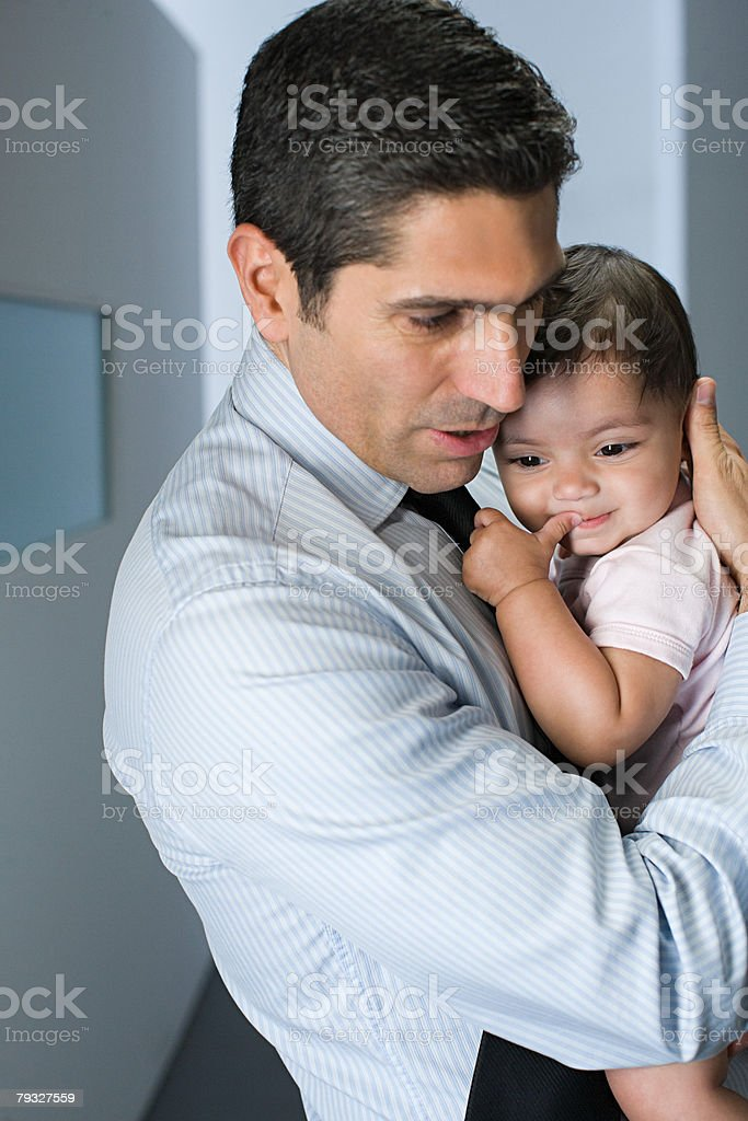 Father holding his baby daughter royalty-free stock photo