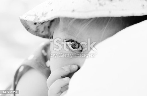 istock father holding his daughter, focus on the eyes 147779209