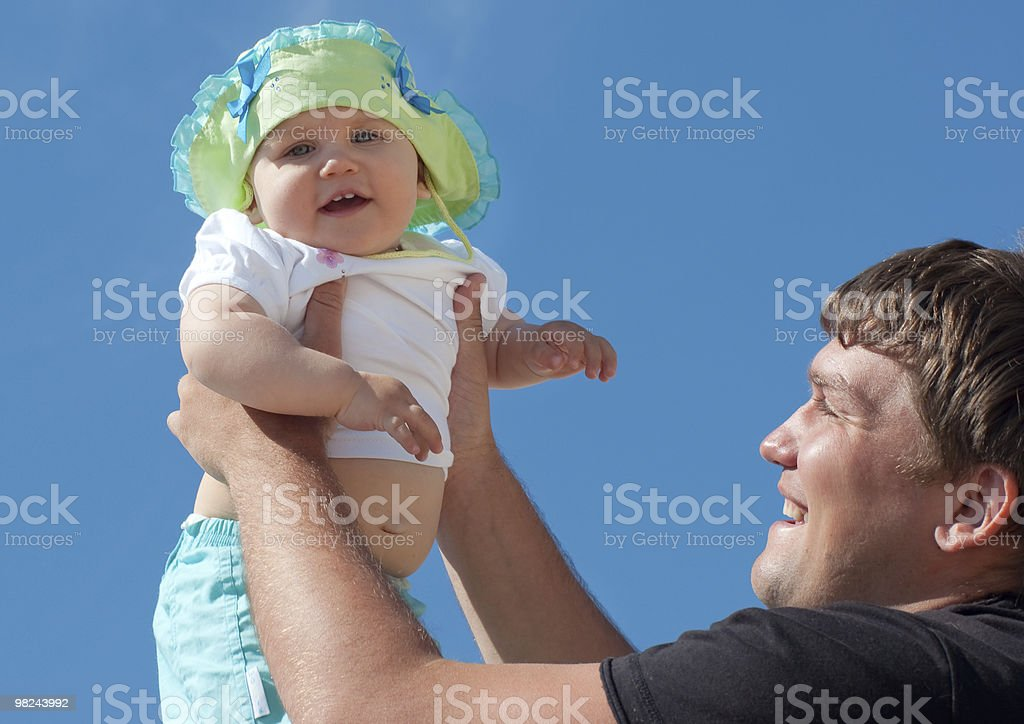 Father holding his daughter royalty-free stock photo