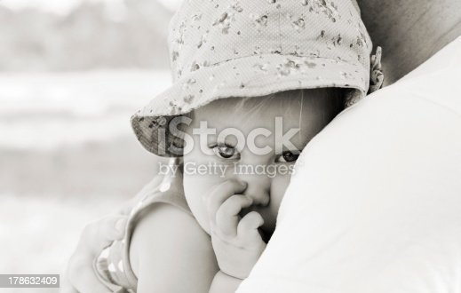 istock father holding his little daughter 178632409