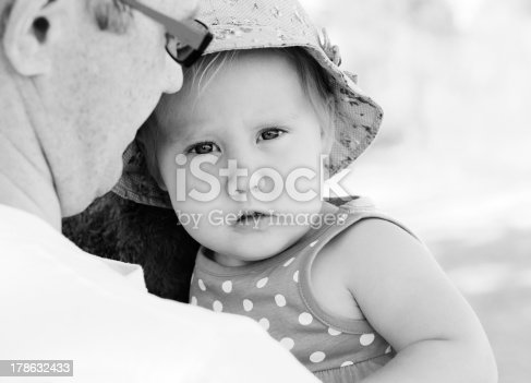 istock father holding his little daughter 178632433