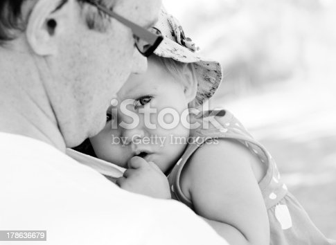istock father holding his little daughter 178636679