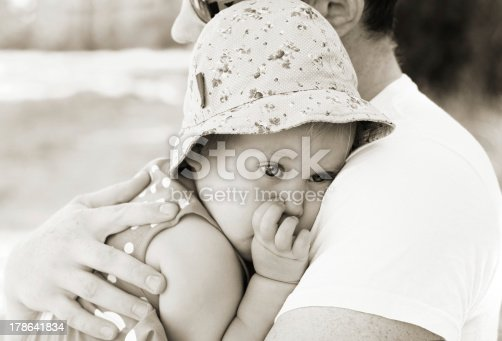 istock father holding his little daughter 178641834