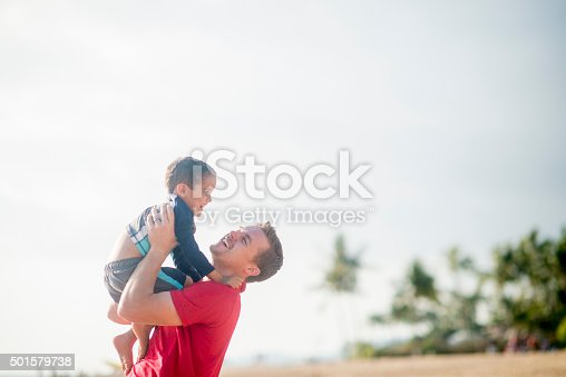 605742160 istock photo Father Holding His Son Up in the Air 501579738