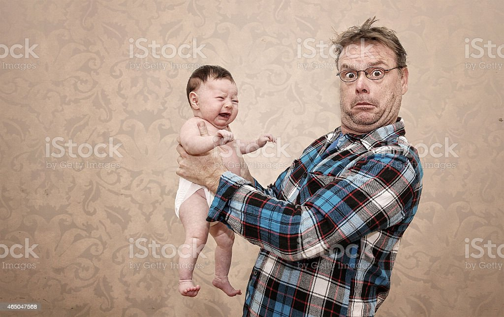 Father Holding his Young Baby stock photo