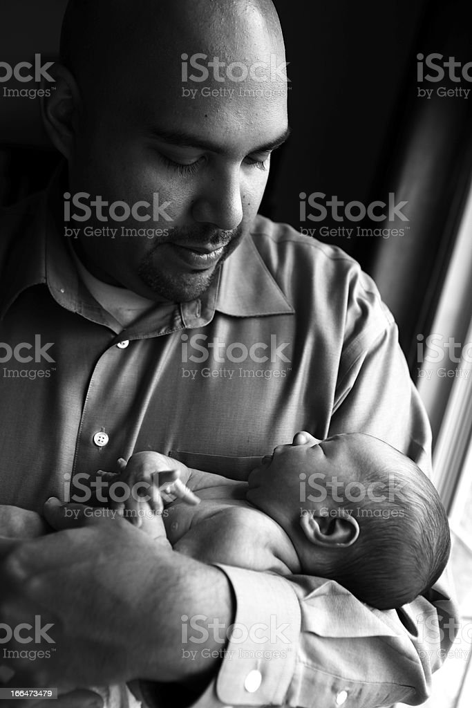 Father Holding Newborn royalty-free stock photo