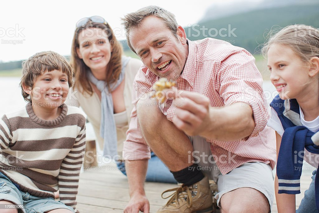 Father holding out small crab royalty-free stock photo