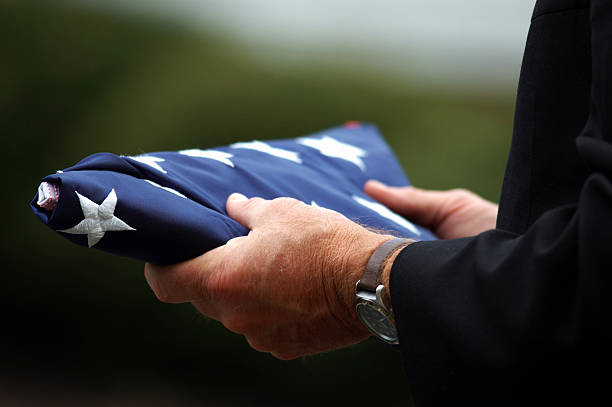 father holding son's flag - folded stock photos and pictures