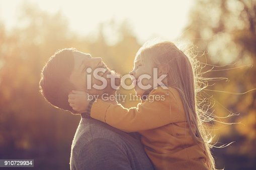 istock Father holds daughter in his arms 910729934