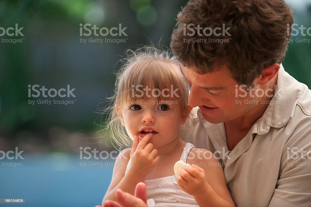 Father holds his inquisitive daughter royalty-free stock photo