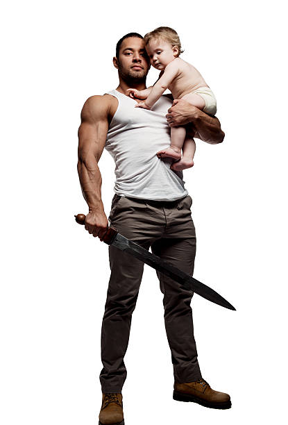 Father hugging a baby and holding a sword stock photo