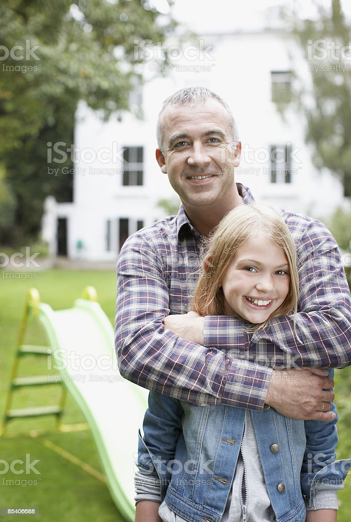 Father hugging daughter outdoors royalty-free stock photo