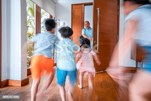 670900812 istock photo Father hugging his children when coming home 968062686