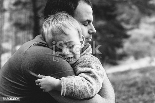 1166996797 istock photo Father hugging his crying son 545093904