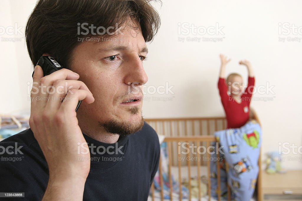 Father ignoring child royalty-free stock photo