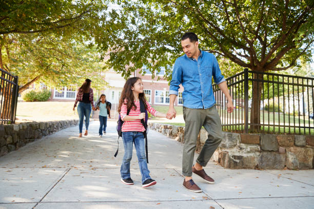 father in collecting daughter at the end of school - day in the life series stock pictures, royalty-free photos & images