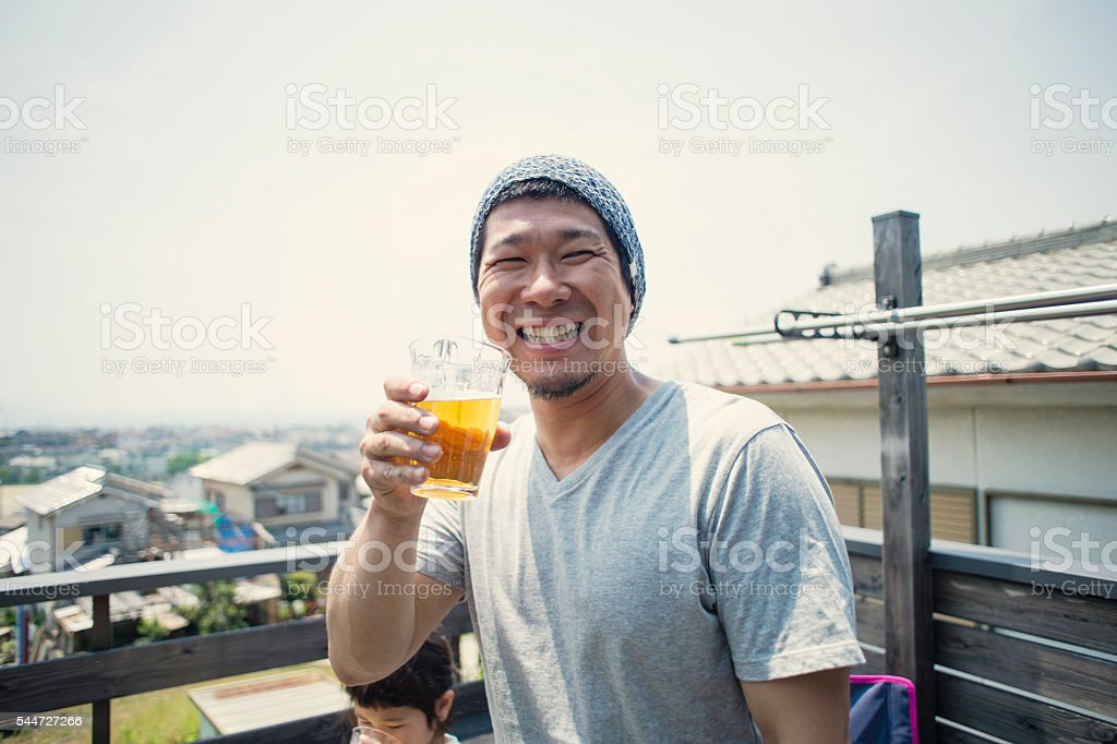 Father is drinking beer stock photo