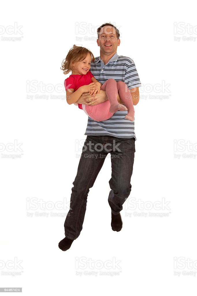 father jumping with daughter in arms royalty-free stock photo