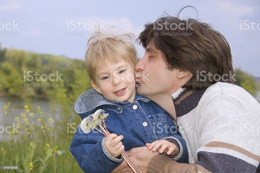 father kiss his little son royalty-free stock photo