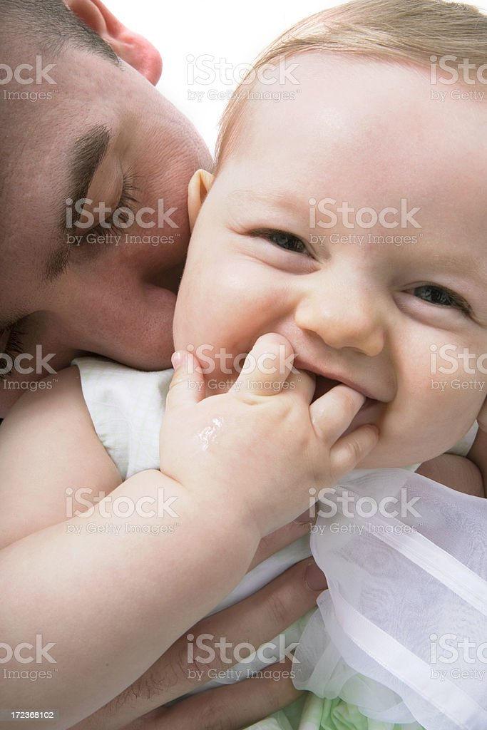 Father kissing baby royalty-free stock photo