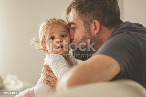 istock Father kissing his adorable girl 852744392