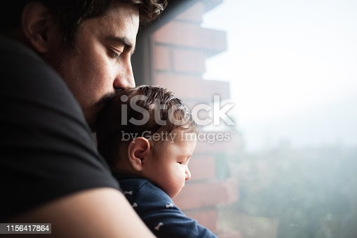 Close up of Father kissing his baby son