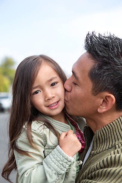 Father kissing his daughter Father kissing his daughter little girl kissing dad on cheek stock pictures, royalty-free photos & images