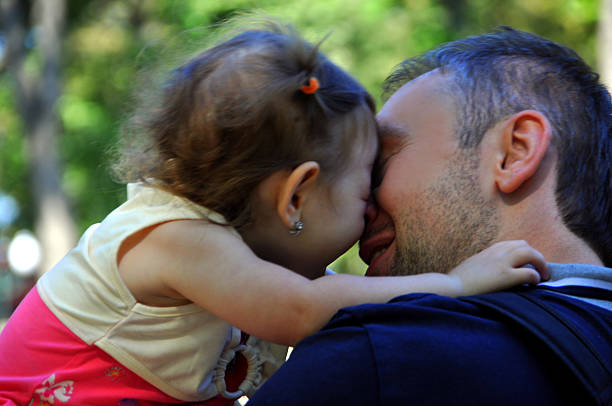 Father kissing his little daughter happy Father kissing his little daughter happy little girl kissing dad on cheek stock pictures, royalty-free photos & images