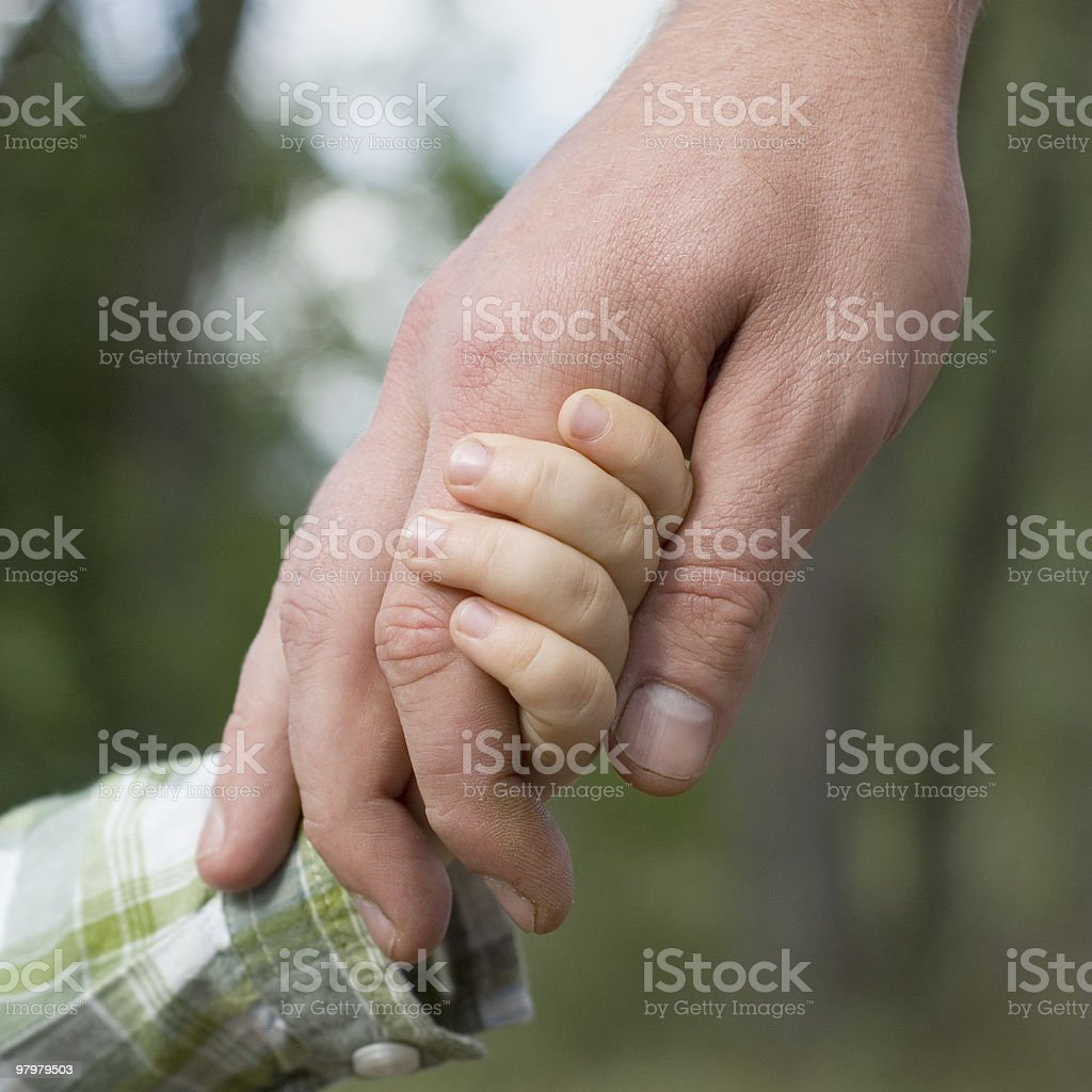 father lead his son by the hand royalty-free stock photo