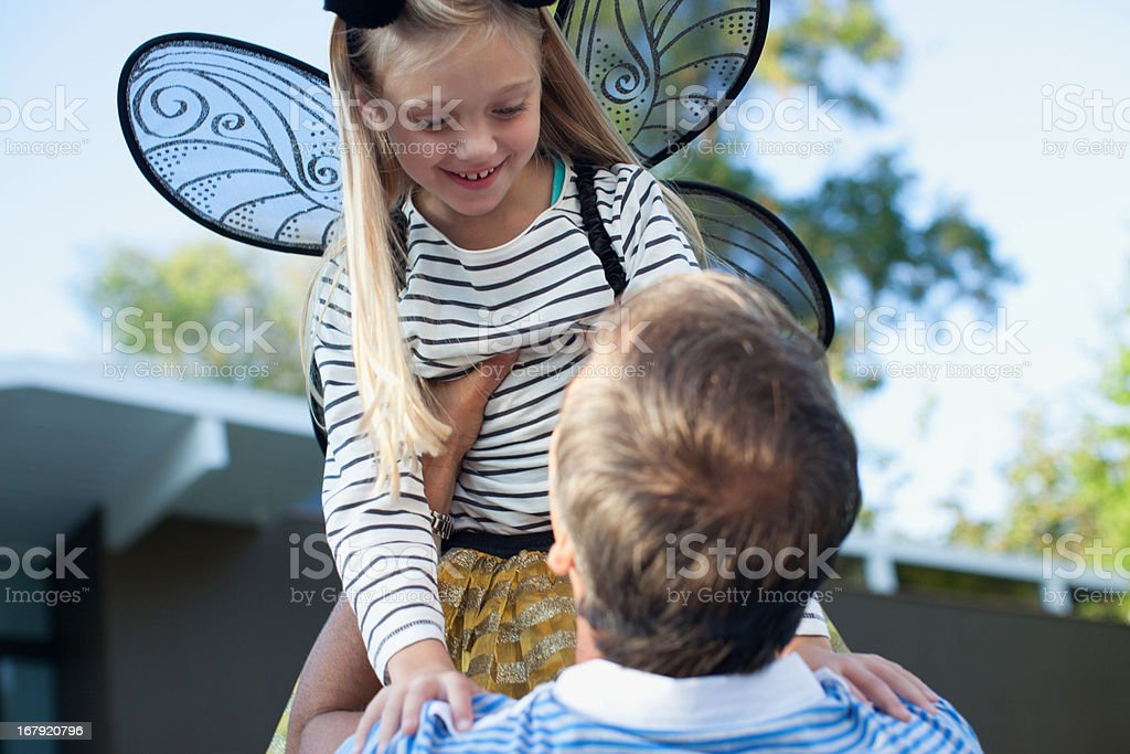 Father lifting daughter in air outdoors royalty-free stock photo