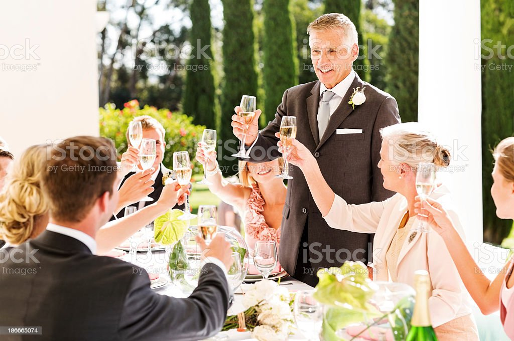 Father Of  The Bride Toasting Champagne At Wedding stock photo
