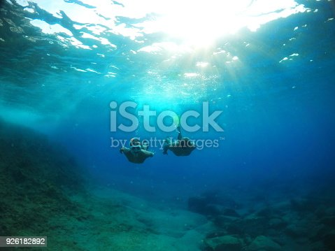 583830686 istock photo Father on Son Exploring under the water 926182892