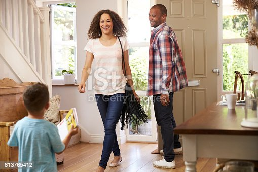 670900812istockphoto Father Opens Front Door For Mother Returning Home From Work 613765412