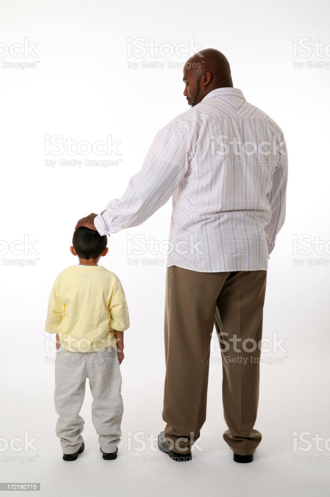 Father pats son's head stock photo