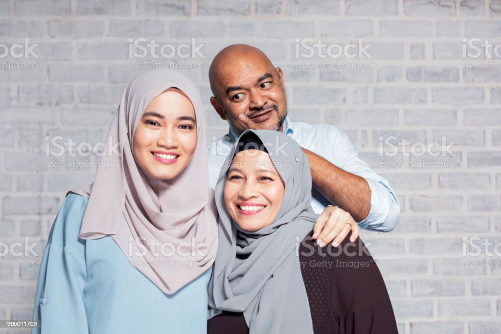 Father photo boming their family portrait at a studio stock photo