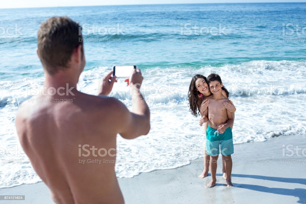 Father photographing happy wife and son royalty-free stock photo