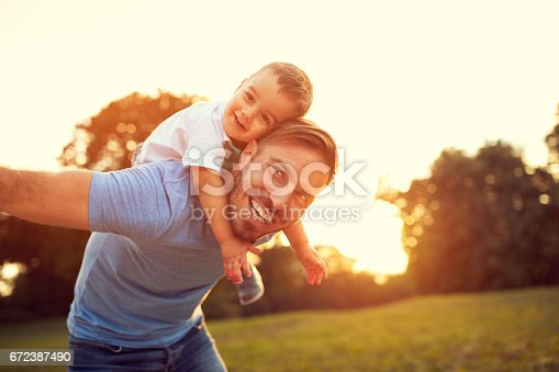 istock Father piggyback his son outside 672387490
