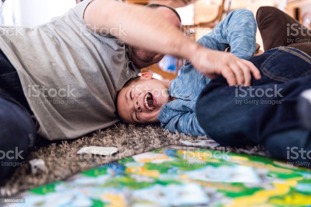 Father play at home with son stock photo