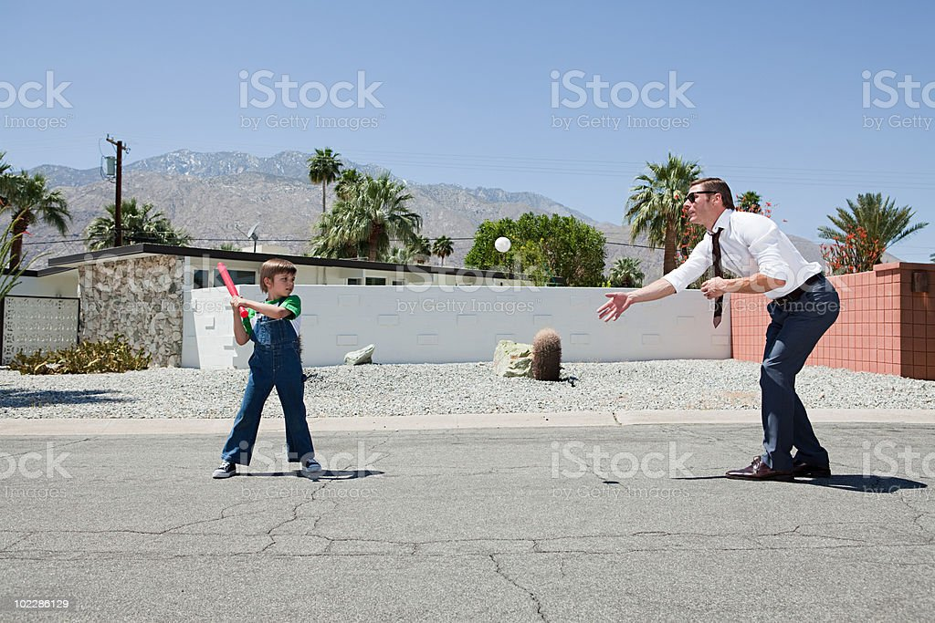Father playing ball with son stock photo