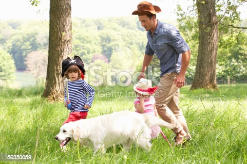 istock Father Playing Exciting Adventure Game With Children Outdoors 156350059