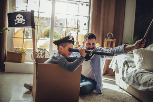 Father Playing Exciting Adventure  Game With Son