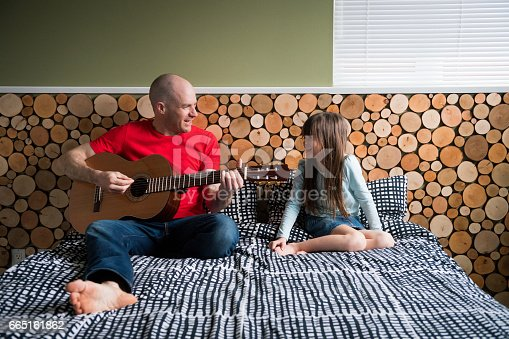 istock Father playing guitar for his daughter 665161862