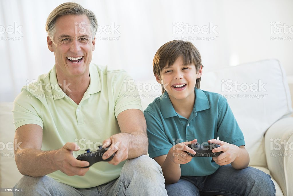 Father Playing Video Game Together At Home royalty-free stock photo