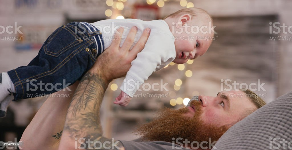 Father Playing with Baby stock photo