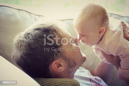 istock Father PLaying with Happy Baby at Home 499662642