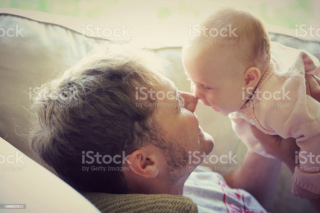 Father PLaying with Happy Baby at Home stock photo