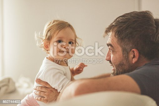 istock Father playing with his baby girl 852744402