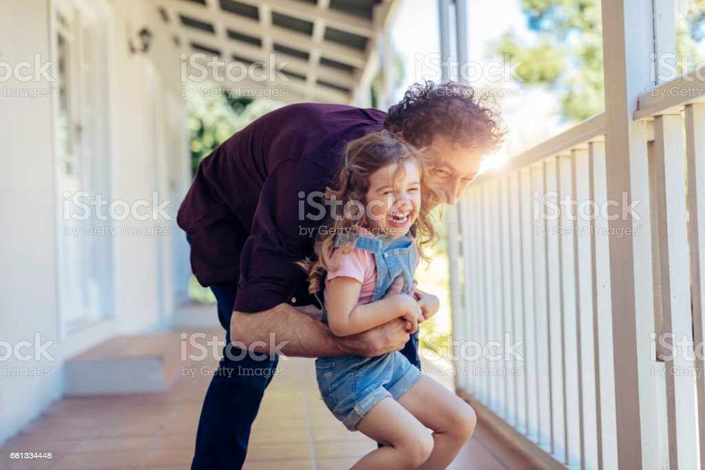 Father playing with his daughter stock photo