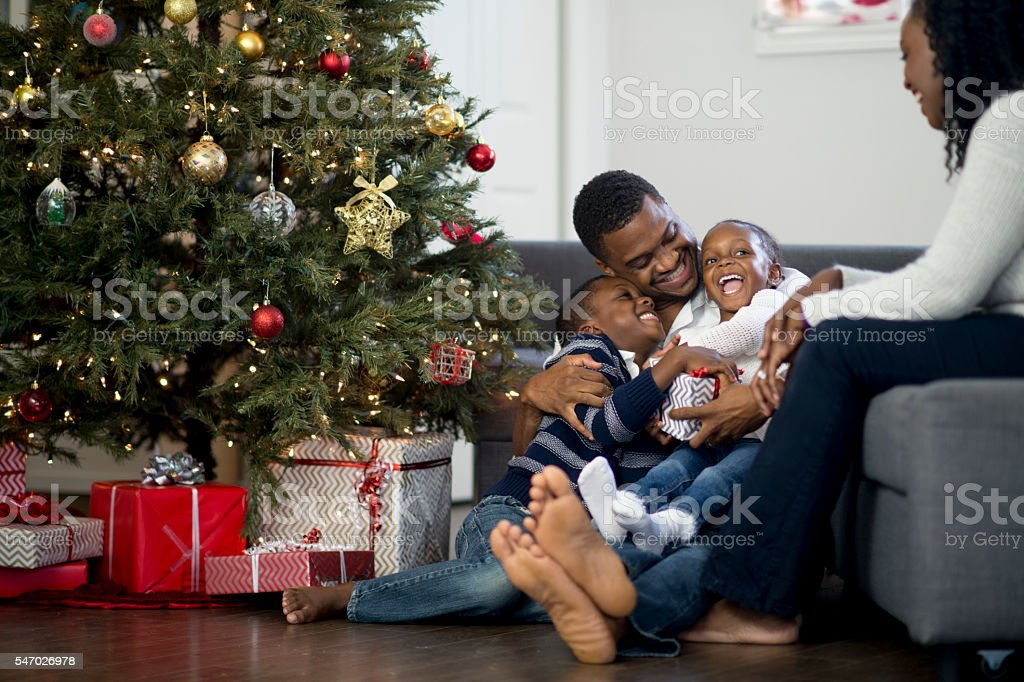 Father Playing with His Kids on Christmas Day stock photo
